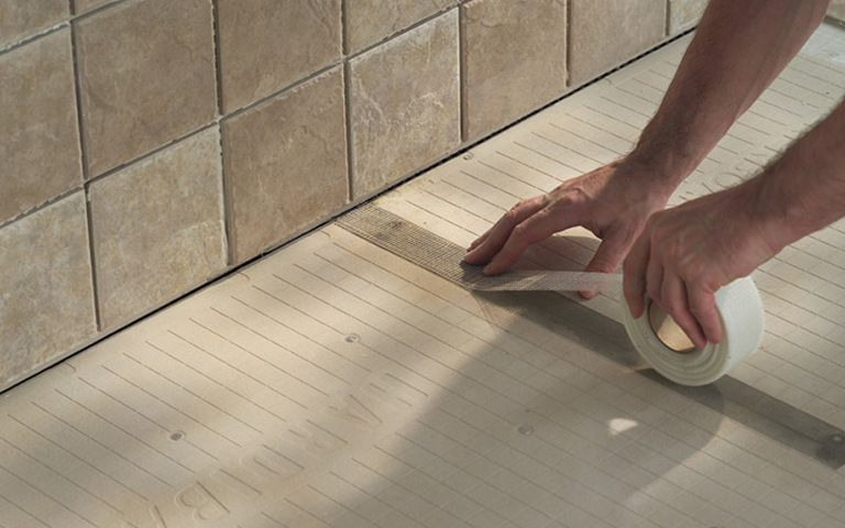 How to use a laser level to install tiles